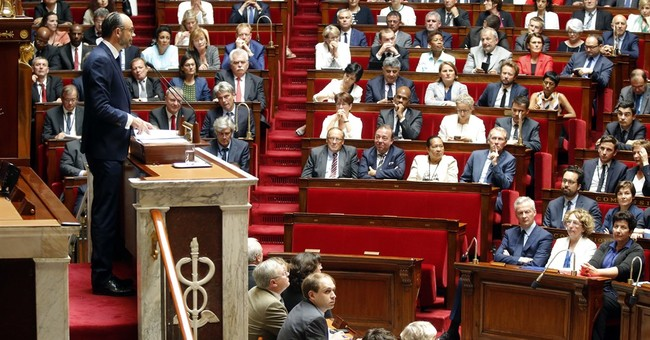 French PM wins confidence vote, vows to cut budget deficit