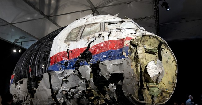 Dutch to try suspects in Malaysia flight downed in Ukraine