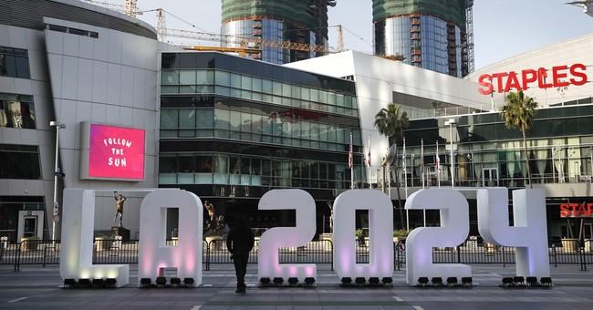 Olympic panel praises 'outstanding' LA, Paris hosting plans