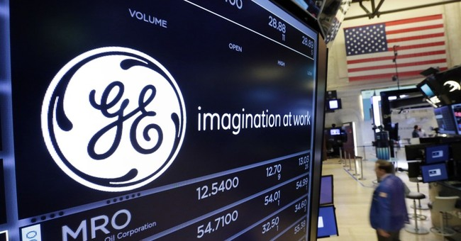 EU authorities suspect GE, Merck, Canon of merger violations