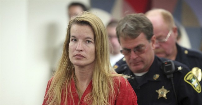 Woman pleads guilty to killing social worker, 3 relatives