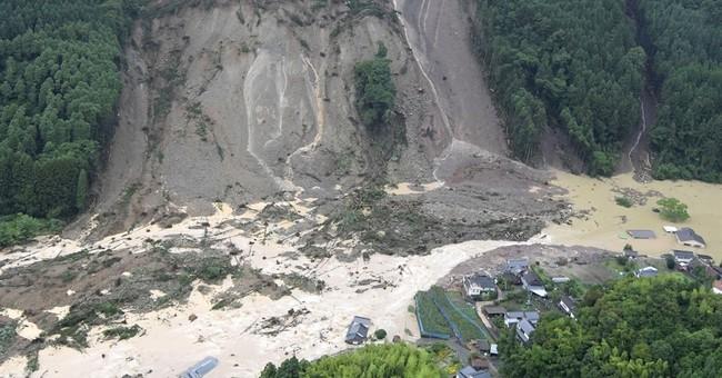 Floods in southern Japan force hundreds to flee; 2 dead