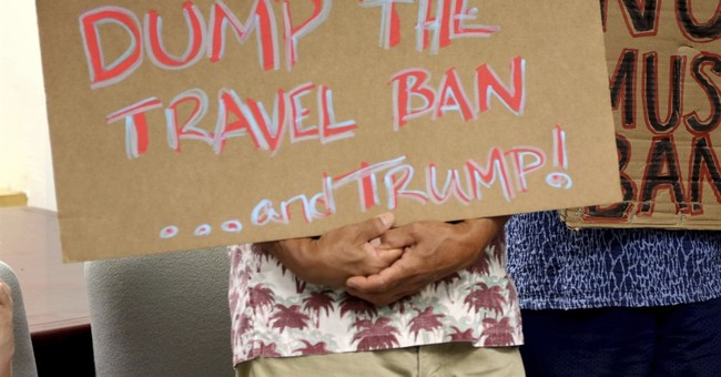 The Latest: Appeals court won't weigh in on travel ban rules