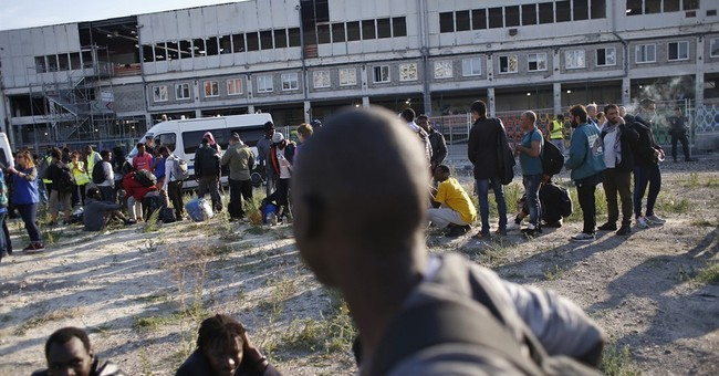 The Latest:  EU official: UN sanctions for migrant smugglers