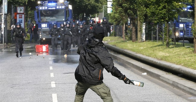 G-20 clashes leave dozens of officers and activists injured