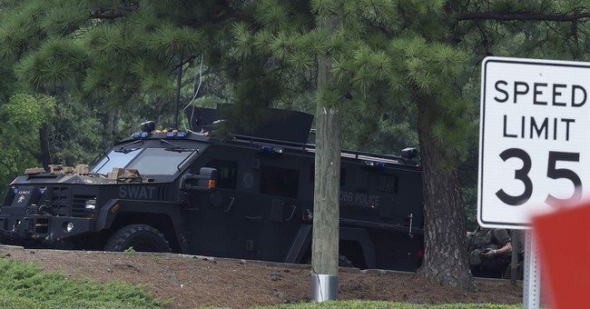 Man claiming to have bomb in bank killed in police standoff