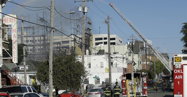 The Latest: Burned crane blocks residents after Oakland fire
