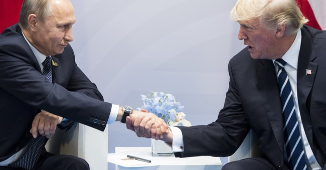 For Trump and Putin, a warm handshake and a long meeting