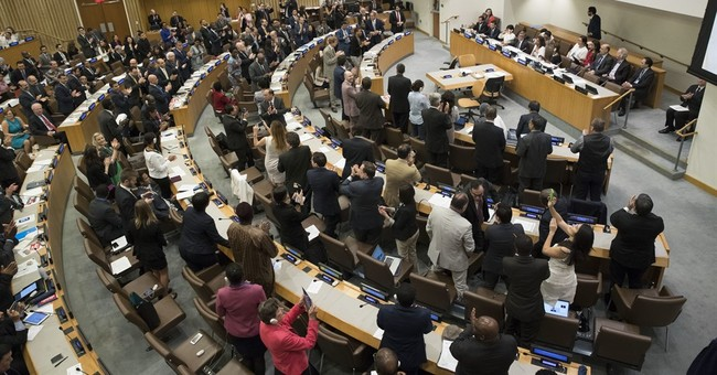 Over 120 nations adopt first treaty banning nuclear weapons