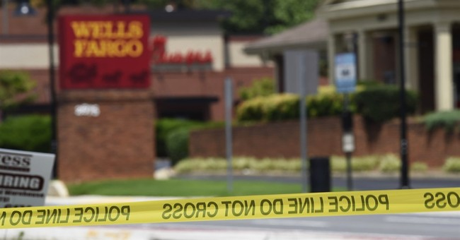 The Latest: Police identify Georgia bank standoff suspect