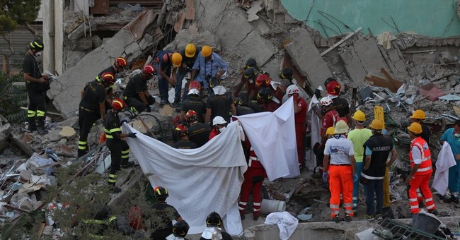 8th body pulled from the rubble in Italy building collapse