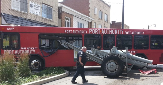Bus hops curb, dislodges war memorial cannon in Pittsburgh