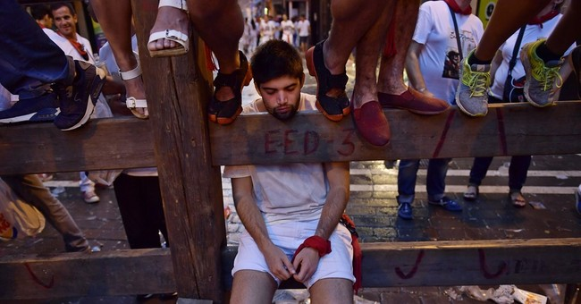 American gored at Pamplona bull run promises to run again