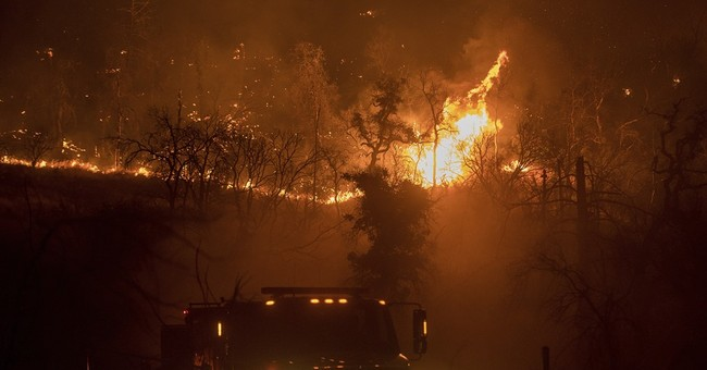 The Latest: Wildfire sends kids at California camp fleeing