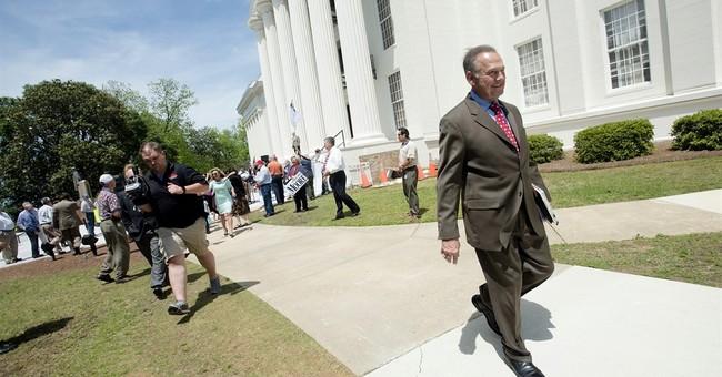 In Alabama Senate race, Roy Moore stirs far right base
