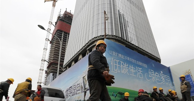 China's growth edges up but 2016 weakest year since 1990