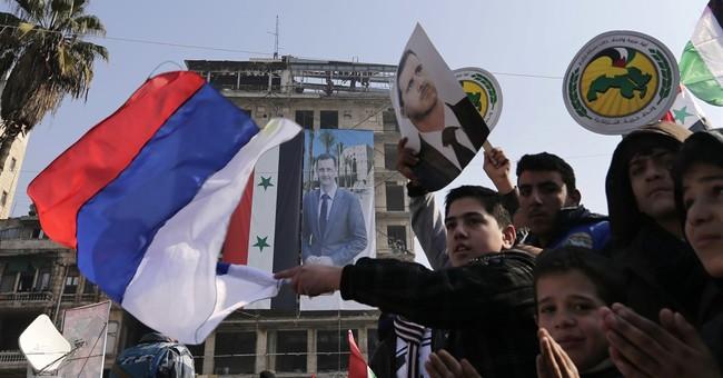 Shelling kills 2 in Aleppo as Assad supporters celebrate