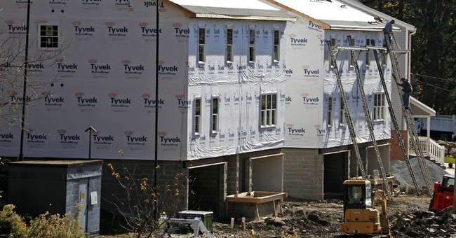 US home construction jumps, led by more apartment building
