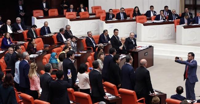 Turkish lawmaker chains self to rostrum, sparks new brawl