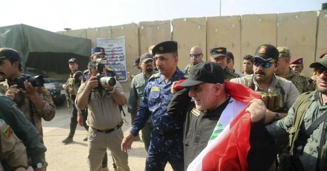 The Latest: US calls Mosul victory a 'critical milestone'