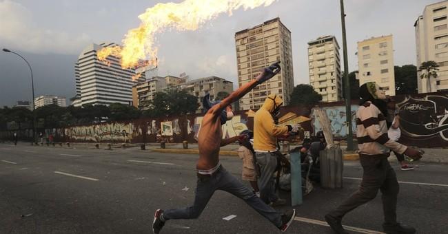 Venezuela marks 100 days of unrest, at a glance