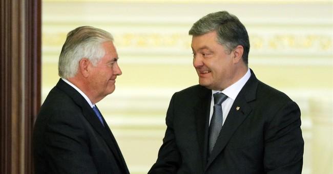 The Latest:  In Ukraine, Tillerson speaks blunty to Russia