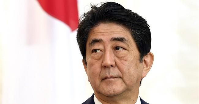 Japan's leader sees popularity sink, seeks Cabinet shuffle