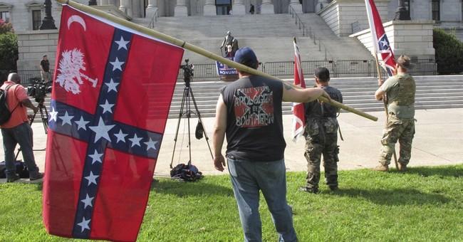Group flies Confederate flag again at South Carolina capitol