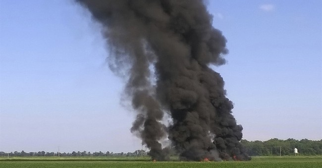 The Latest: Governor warns against taking plane crash debris