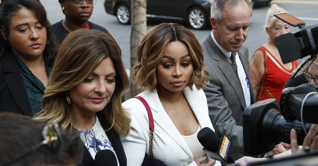 The Latest: Blac Chyna says Rob Kardashian hit her in April