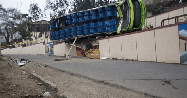 Sightseeing bus crashes in Peru capital, killing at least 9