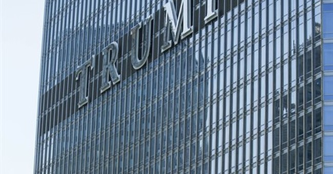Activists charged after banner hung at Chicago's Trump Tower