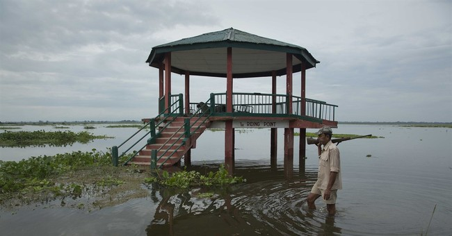 Police patrol for poachers as animals flee flooding in India