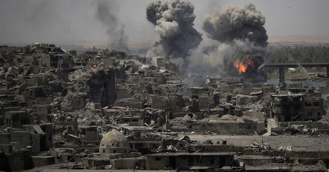 Clashes shake west Mosul after victory over IS declared