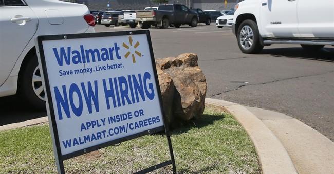 US job openings slipped in May, but hiring increased