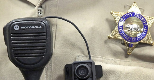The Latest: Panel advances body cam video transparency bill