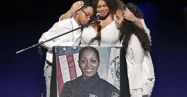 The Latest: Funeral for slain NYC police officer concludes