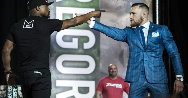 McGregor makes fun of Mayweather's tax problems