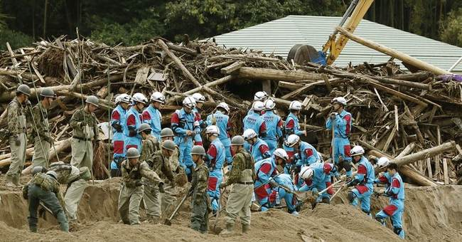 2 more deaths as Japan leader Abe visits flooded areas