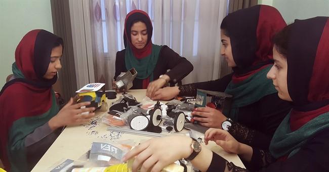 The Latest: Afghan girls robotics team arrives in Kabul