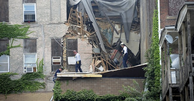 The Latest: Woman trapped in partial building collapse freed