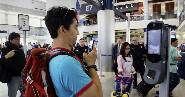 Face scans for Americans flying abroad stir privacy issues