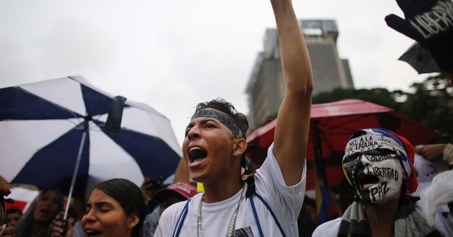 Venezuela cop in helicopter attack attends opposition rally