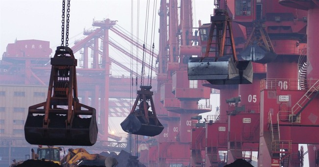 China defends imports of North Korean iron ore