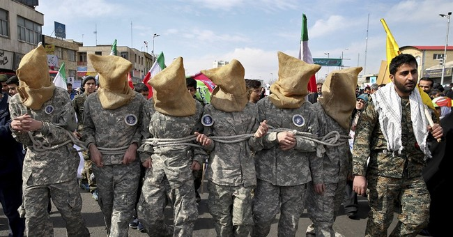 Iranian researcher denied US entry has ties to militia