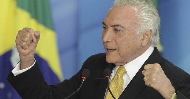 The Latest: Brazil president praises house committee's vote