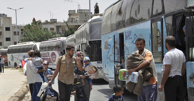 Weary Syrians trickle back home to government-held areas