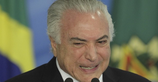 Embattled Brazil president signs labor reform into law