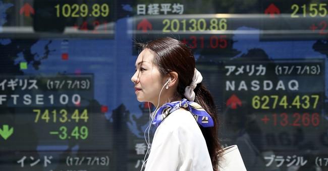 Asian markets edge higher as investors await earnings