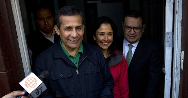 The Latest: Ex-Peru leader, wife surrender for detention